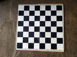 black and white empty chess board on stone background