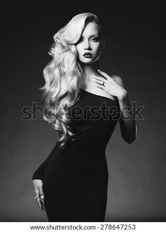 Black and white fashion art photo of elegant blonde on black background