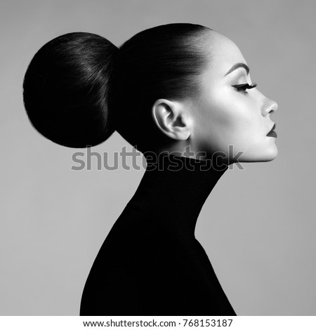 Black and white fashion art studio portrait of beautiful elegant woman in black turtleneck.  Hair is collected in high beam.  Elegant ballet style #768153187
