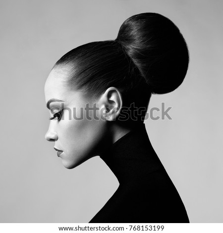 Black and white fashion art studio portrait of beautiful elegant woman in black turtleneck.  Hair is collected in high beam.  Elegant ballet style - Shutterstock ID 768153199