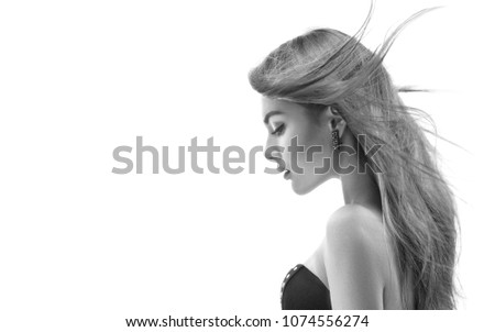 Black and White Fashion Model Girl profile Portrait with Long Blowing Hair. Glamour Beautiful Woman with Healthy and Beauty Hair isolated on white background. Fluttering hair