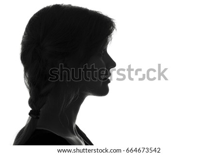 Black and white fashion portrait profile silhouette of face of a beautiful young woman with a hairstyle on her head #664673542