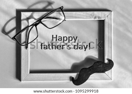 Black and white. Fathers day. Homemade gift box, the symbols of Father's Day-glasses, mustaches, Best father. Child and father concept. Happy fathers day text. Composition in a frame.