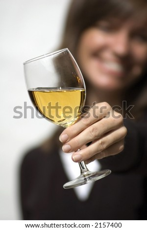 Black and white female model on white background raising a wine glass