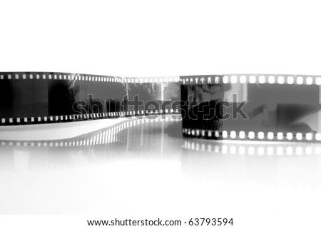 black and white Film strip in front of a white background .