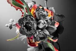 black and white flower buds and graphic elements on a gray background, abstract floral composition.