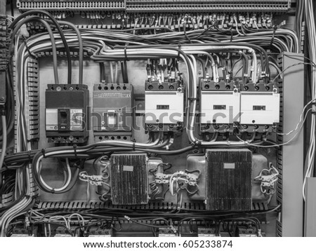 Black and white front shot of electric panel that shows red, blue ...