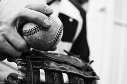 Black and white graphic for print or decor of baseball player holding ball in hand and mitt to pitch.  Good for man cave, game room or sports theme industry.