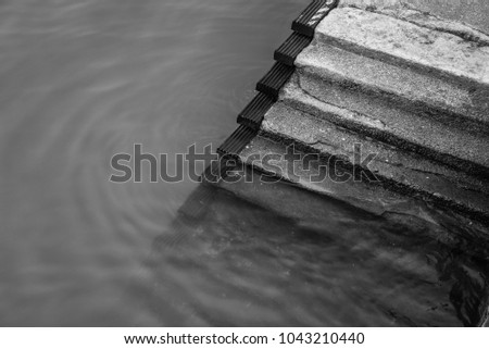 Black and White Half-submerged Staircase Taken at a dock #1043210440