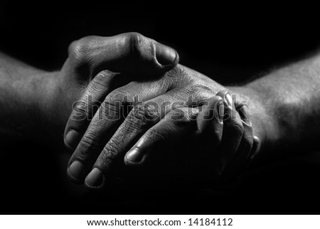 Black and white hands of man