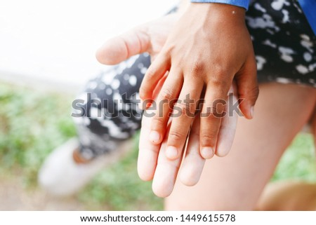 Black and white hands put together. International friendship, unity, togetherness , race equality, help concept.
