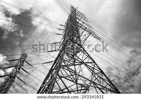 Black and white High voltage AC transmission towers / Electric Power transmission lines
