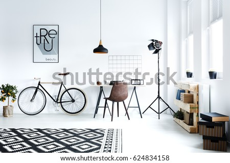 Black and white hipster room with bicycle, desk, pattern carpet