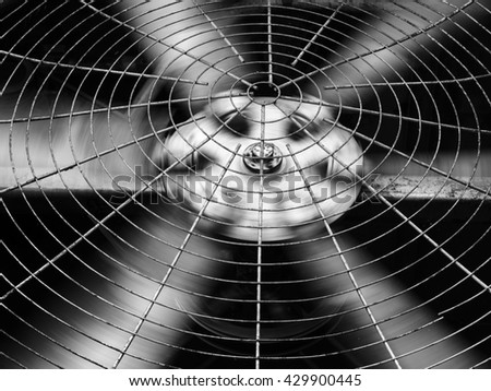 Black and white HVAC (Heating, Ventilation and Air Conditioning) spinning blades. Industrial ventilation fan background. Air Conditioner Ventilation Fan.