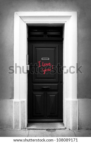 Black-and-white illustration of door with inscription I love you.