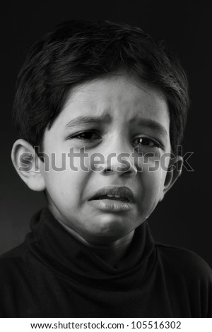 Black and white image of a crying kid