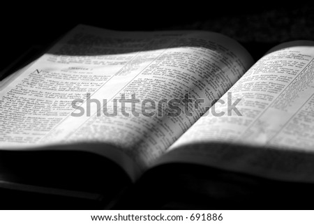 Black and White image of a family Bible in sunlight and shade, opened to Matthew Chapter 2 ~ The 3 wise men come to worship Jesus.