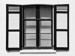 Black and white image of a rustic window