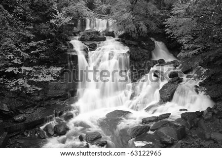 Black and white image of Bastion Falls at high water during a fall flood  in the Catskills Mountains of New York