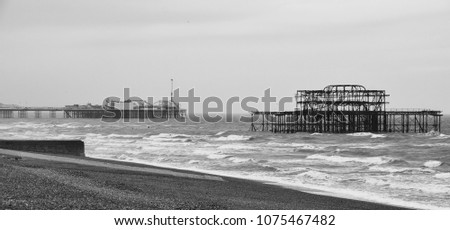 Black and White image of Brighton Pier and West pier #1075467482