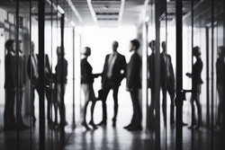 Black and white image of business people at office