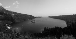 Black and white image of Emerald Bay nestled in the mountains and forests of the southern shores of Lake Tahoe, California