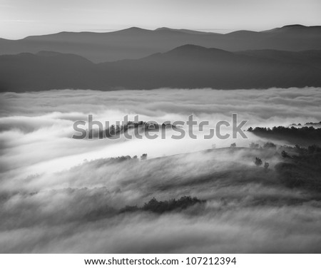 Black and white image of foggy mountains