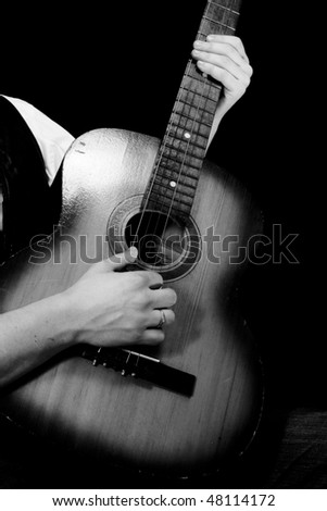 black and white guitar player. stock photo : black and white image of guitar player
