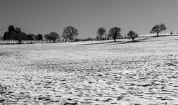 Black and white image of landscape in winter in Europe.