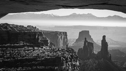 Black and White image of Mesa Arch and surrounding Moab Area in Southern Utah