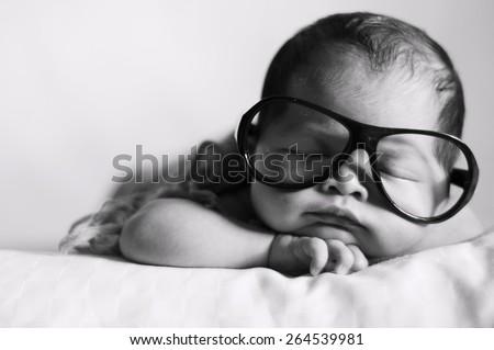 Black and White Image of Newborn Baby