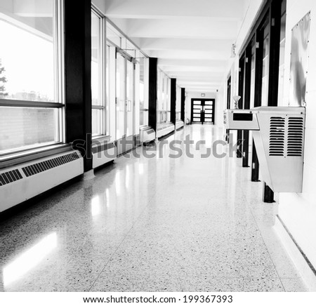 Black and white image of school drinking fountain