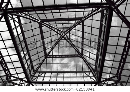 Black and white image of the glass roof of a mall