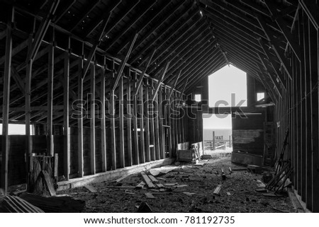 Black And White Images Of The Interior An Old Abandoned Barn In Montana