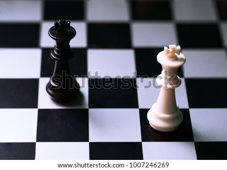 Black and white kings on chess board. Chess figure king. Black and white chess figurine. Stalemate position on chessboard. Strategic task. Business competition and risk concept. Chess game piece Сток-фото ©