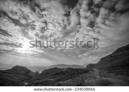 Black and white landscape with dramatic cloudy sky