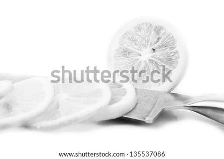 Black and white Lemons and slice on a white background
