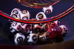 Black and white lottery balls in a bingo machine. Lottery balls in a sphere in motion. Gambling machine and euqipment.