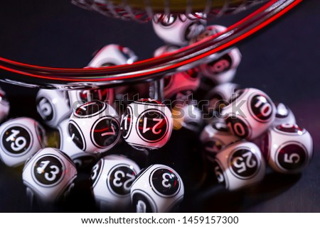 Black and white lottery balls in a bingo machine. Lottery balls in a sphere in motion. Gambling machine and euqipment. Number 21.