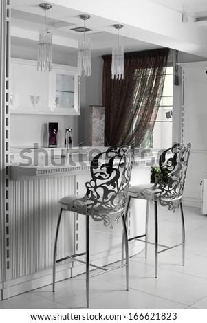 black and white luxury kitchen interior with modern furniture