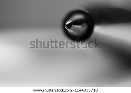 Black and white ,.macro picture of tip a ballpoint pen, also known as a biro or ball pen , closeup, ball in focus