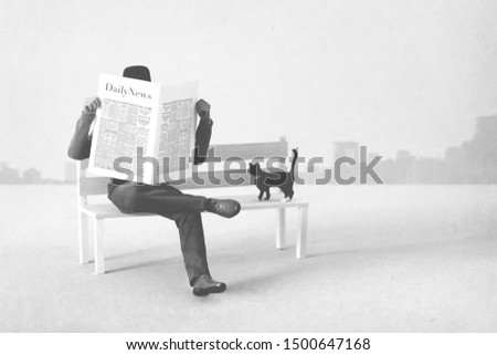 black and white man sitted on a bench reading newspaper