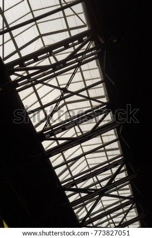 Black and white modern building roofing struts and clear glass panels found in many modern architectural designs and constructions