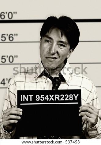 black and white mugshot of a man