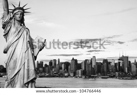 black and white new york city midtown manhattan skyline cityscape over hudson river. statue of liberty photo new york city black and white hi contrast effect usa america.
