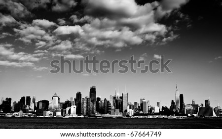 black and white new york city skyline cityscape over hudson river