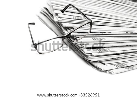 Black and white newspaper and glasses