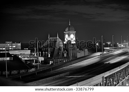 Black and white of a clock tower over Interstate 95.