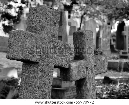 black and white of a close up of tombstones