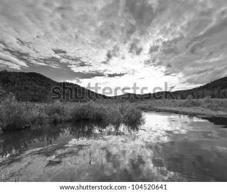 Black and white of a lake inlet at sunset